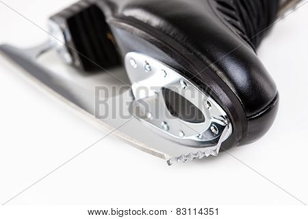 Closeup Shot Of Sharp Cog Of Professional Male Figure Skate. Over White Background