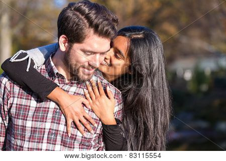 Girlfriend And Boyfriend Hugging And Kissing Outdoors