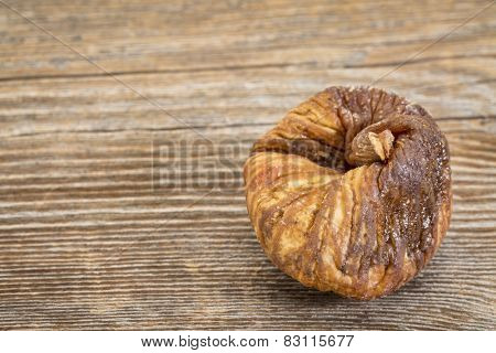 dried Turkish fig on a grained wood background