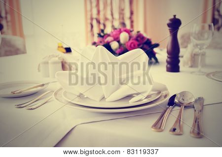 Place setting in an expensive haute cuisine restaurant, toned image