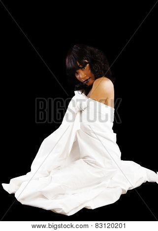 African American Woman Sitting On Floor In White Sheet