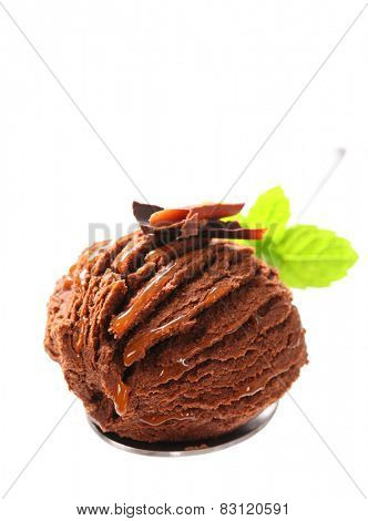 Scoop of chocolate fudge ice cream on spoon