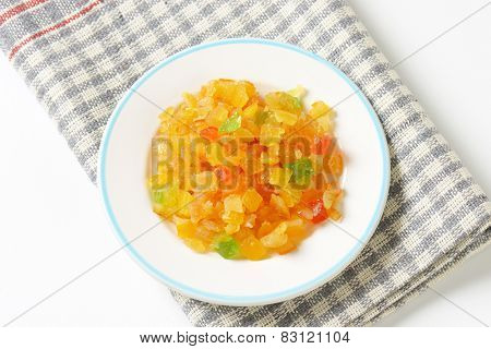 plate of candied tropical fruits on checkered dishtowel