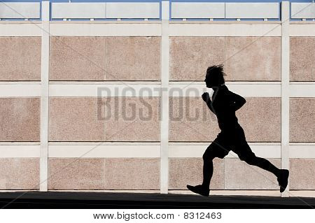 Physically Fit Man Runs For Exercise