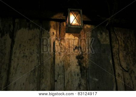 Candle halo guards a mysterious wooden door