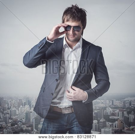 Successful businessmen sunglasses standing in the city town urban background. Luxury, ambitious, con