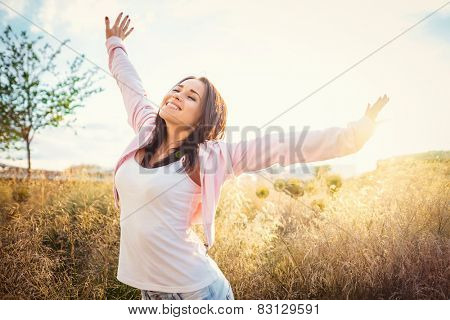 Happy young girl in the field