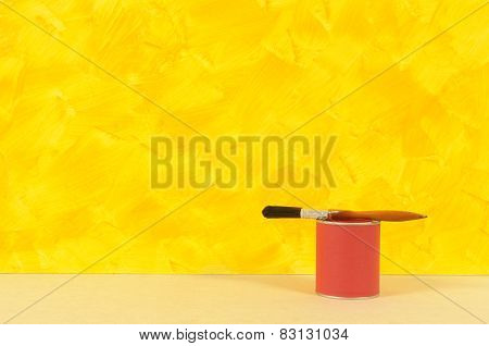 Painted Yellow Wall With Red Paint Tin