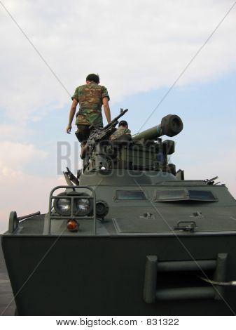 Military - soldiers on tank with machine gun