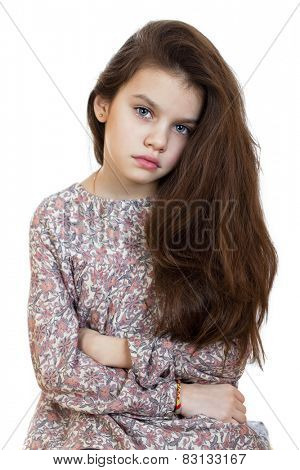 Sad little girl, isolated on white background