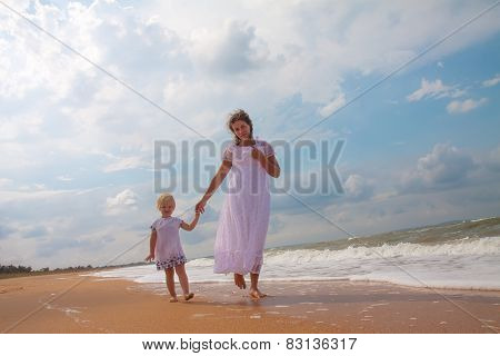 Mother And Daughter Enjoying Time At Beach