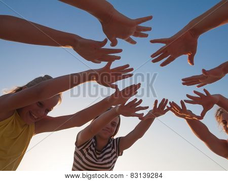 Group Of Friends  Hands On Sky Background