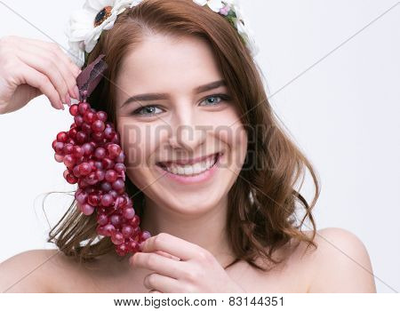 Portrait of a smiling beautiful woman holding currant