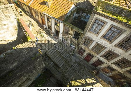 PORTO, PORTUGAL - FEB 17, 2015: Top view one of the streets is the Old Town at Porto. In 1996, UNESCO recognised Old Town of Porto as a World Heritage Site.