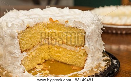 Coconut Cake With Pie In Background