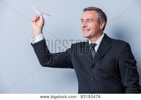 Businessman With Paper Airplane.