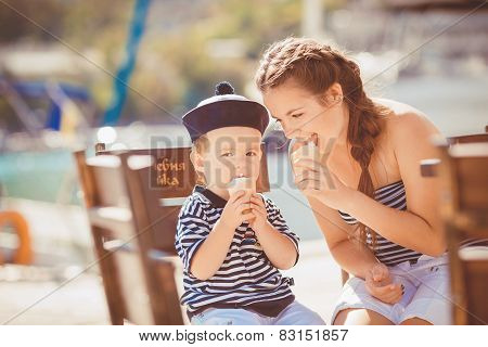 Brother and sister having a good time near the sea in the dock.