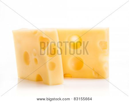 Piece of emmenthal cheese on white background, close-up.