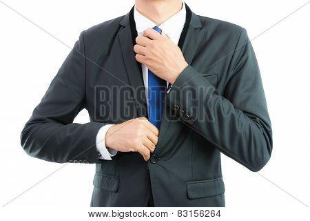 Businessman Adjusting Necktie Isolated