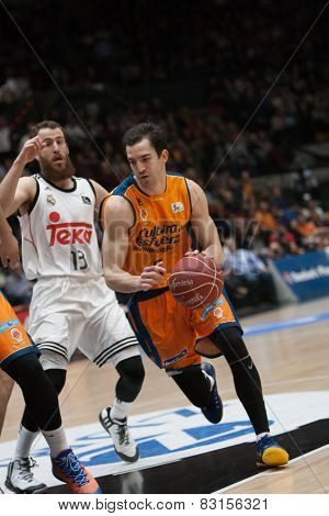 VALENCIA, SPAIN - FEBRUARY 15: Ribas with ball, Rodriguez during Spanish League match between Valencia Basket Club and Real Madrid at Fonteta Stadium on February 15, 2015 in Valencia, Spain