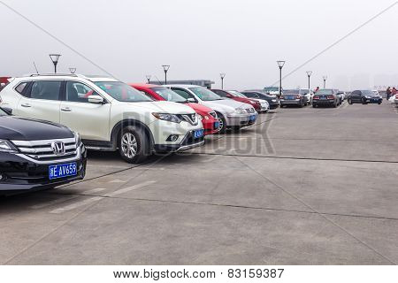 HUZHOU,CHINA - FEB 17: Parking uncovered on February 17th 2015 in Huzhou.China's automobile market over the next 10 years will be an annual growth rate of around 12%.
