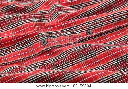 Man's red cotton plaid shirt detail