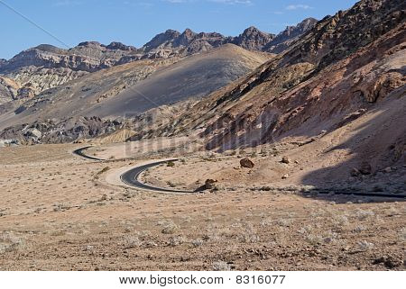 Curved road in Death Valley desert
