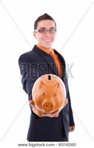 Man Holds A Piggy Bank