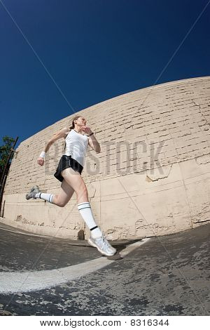 Woman Sprints Towards The Finish Line.