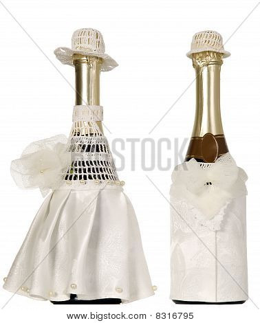 Two Champagne Bottles Dressed With Fabric