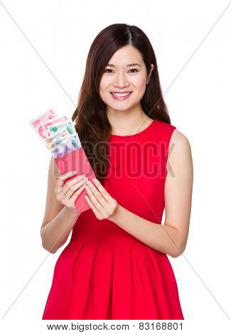 Woman hold red pocket with RMB