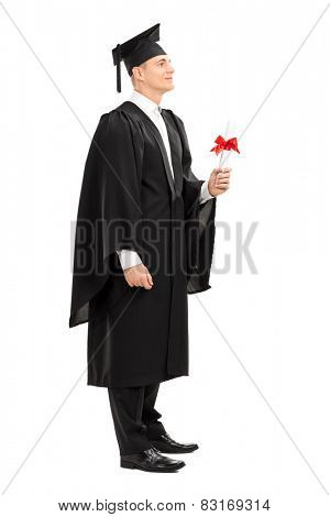 Full length portrait of a proud college graduate holding a diploma isolated on white background