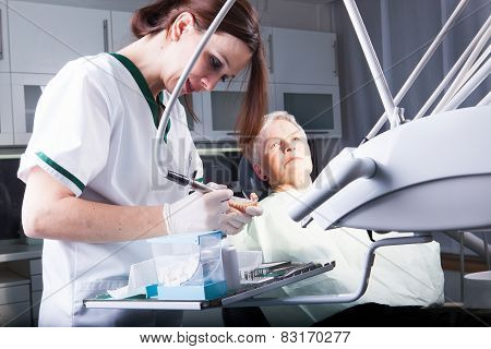 Professional woman dentist doctor working.Senior woman at dental clinic