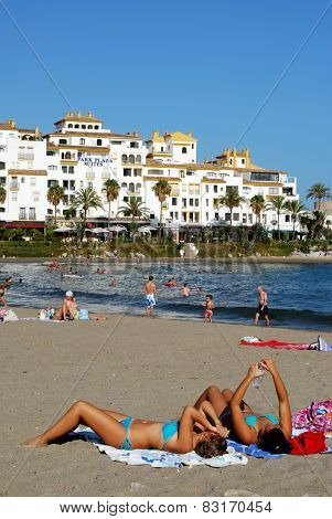 Sunbathers on beach, Marbella.