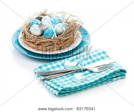 Easter eggs nest on plate with silverware. Isolated on white background