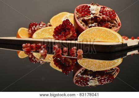 Pomegranate and orange wedges
