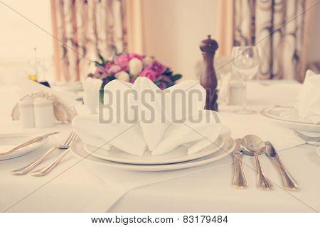 Table arrangement in an expensive haute cuisine restaurant, toned image