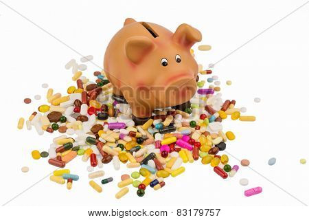 tablets lying next to a piggy bank. symbolic photo for costs in medicine and pharmaceutical industry