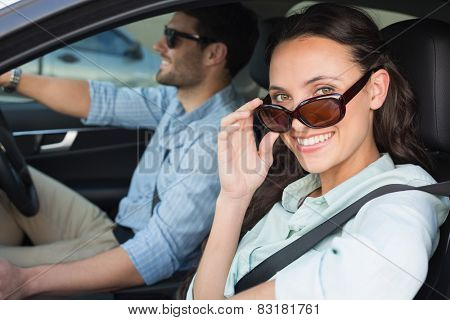 Young couple on a road trip in their car