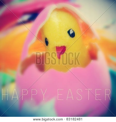 the text happy easter written on a blurred image of a teddy chick emerging from a pink easter egg