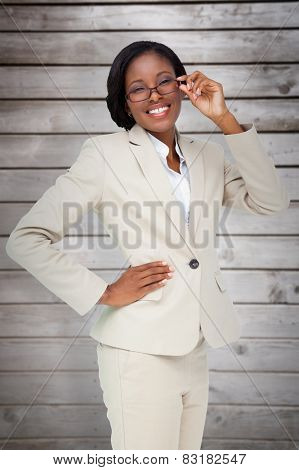 Thinking businesswoman against wooden planks