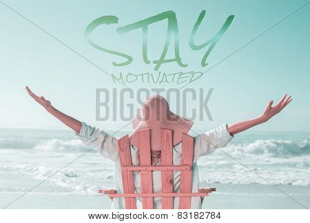 Woman relaxing in deck chair by the sea against stay motivated