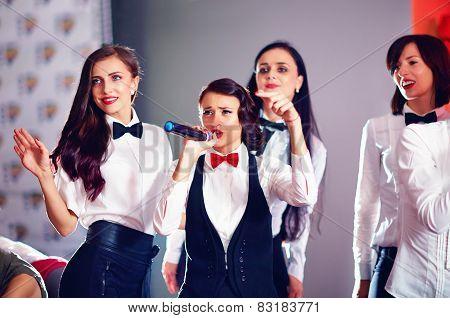 Pretty Women Having Fun On Karaoke Party