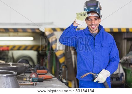 Professional Welder Posing With Wellding Machine