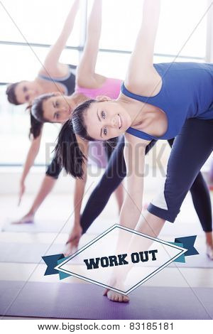 The word work out and class doing stretching pilate exercises in fitness studio against badge