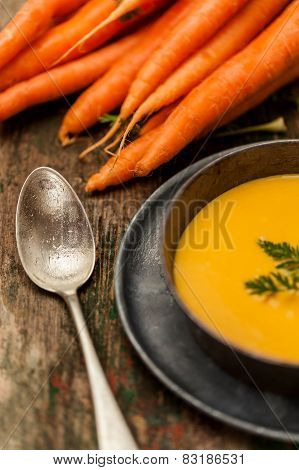 Carrot Cream Over A Wood Background