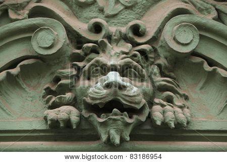 Lion head. Funny mascaron on the Art Nouveau building in Prague, Czech Republic.