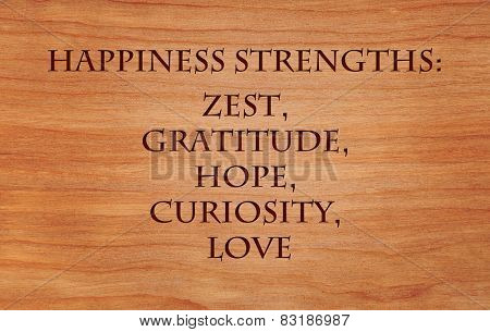 Happiness strengths - zest, gratitude, hope, curiosity, love - list of character strengths for recipe of happiness - on wooden background