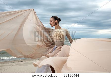 Closeup Portrait Of Model Face During Posing With Long Dress At Beach