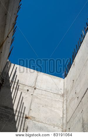 Grey Concrete Walls With Reinforcing Bars